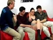 Three men caress hot pregnant chick